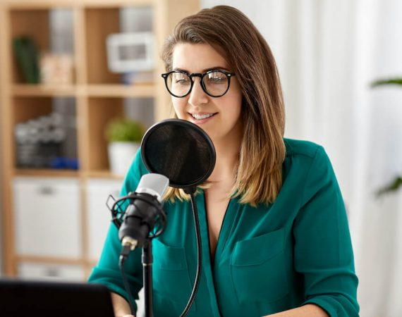 A young female recording a podcast episode