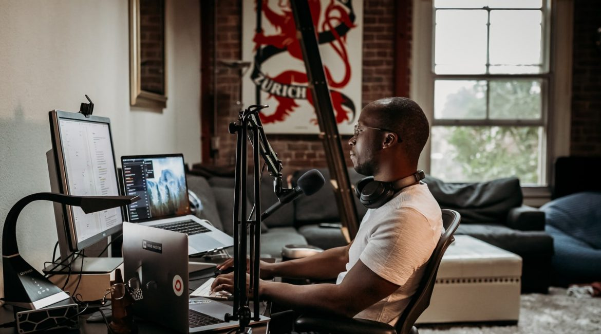 Male podcaster working on his marketing strategy to grow his listenership